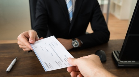 How do I set up payroll after taking on my first member of staff?