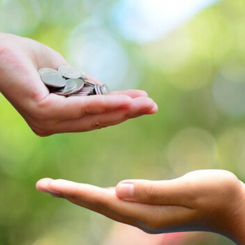 A person giving money