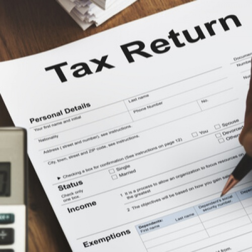 Accountant filling in the tax return