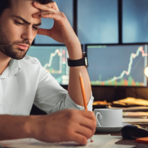 Businessman thinking hard about unpredictable business growth