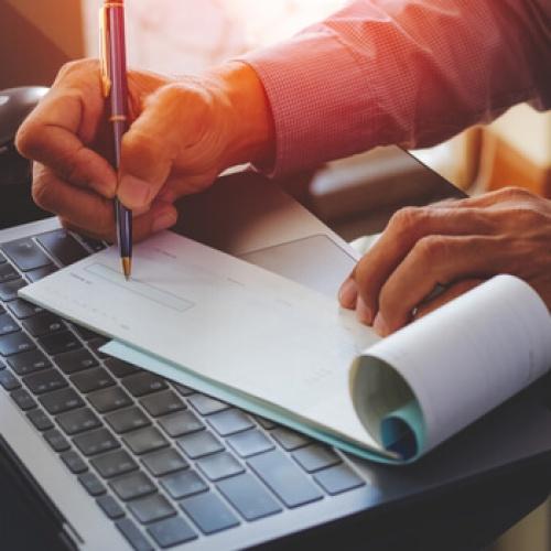 Businessman writing payroll