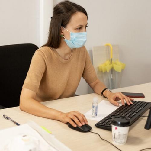 Female accountant wearing a mask