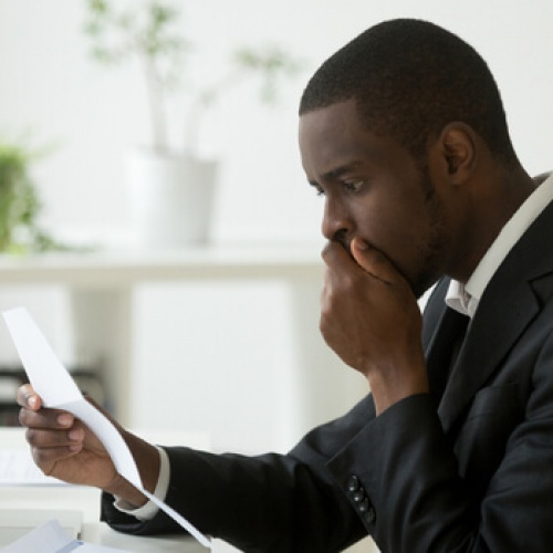 Shocked man reading a notification