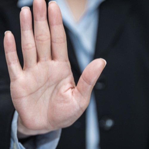 Business woman showing her palm meaning stop