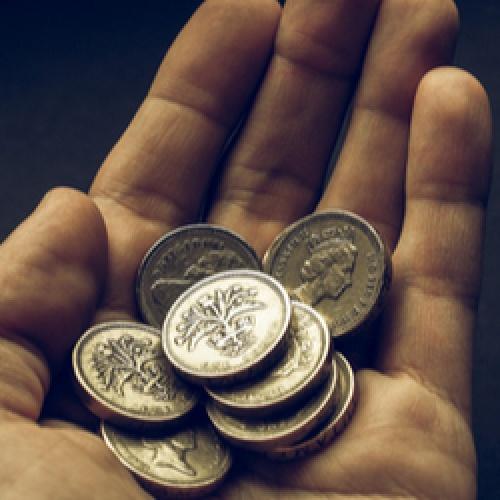 Pound coins in hand