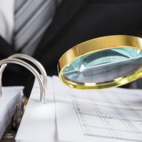 Businessman examining tax