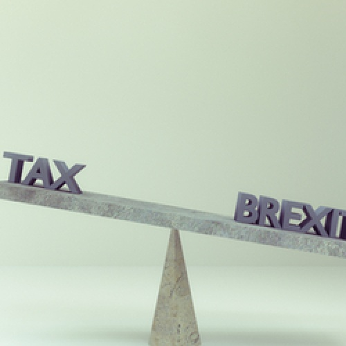 A balancing board of words containing Tax and Brexit