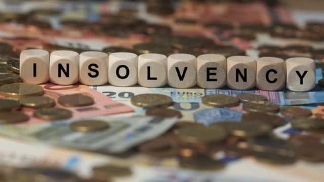 How does an accountant spot potential signs of client insolvency?